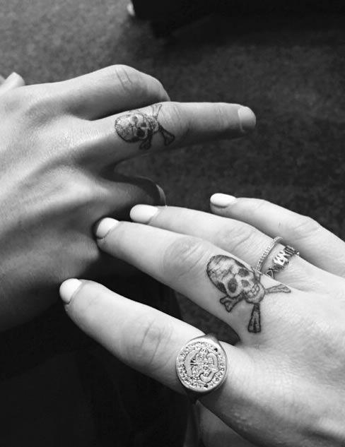 Check Out Ellie Goulding's Cool New Skull Tattoo On Her Finger! http://www.popstartats.com/ellie-goulding-tattoos/finger-skull-crossbones/