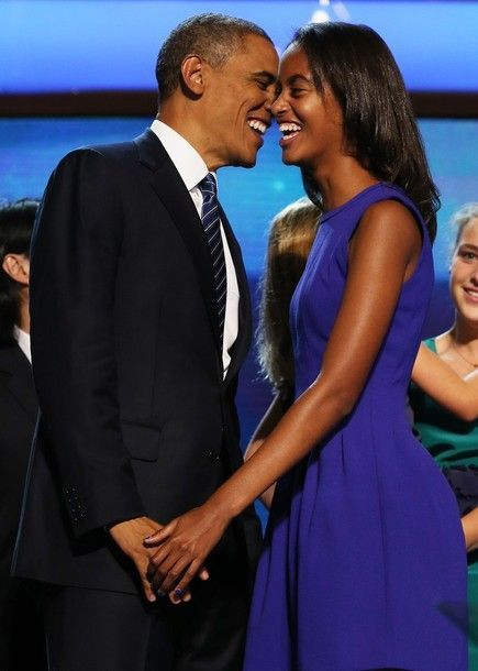 Democratic presidential candidate, U.S. President Barack Obama stands on stage with Malia Obama after accepting the nomination during the final day of the Democratic National Convention at Time Warner Cable Arena on September 6, 2012 in Charlotte,...