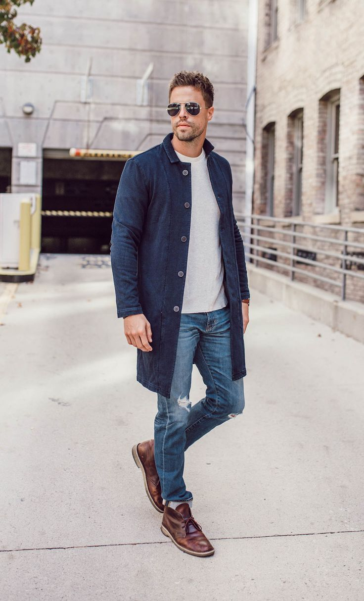 Long denim jacket + white top + distressed jeans + brown chukka boots
