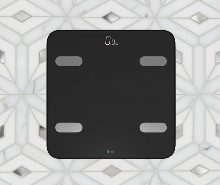 Black body fat PiFit Smart Scale on marble floor.