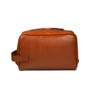 TIGER OF SWEDEN  TIGINO LEATHER TOILET BAG  €120  A spacious and stylish toilet bag in brown leather from Tiger of Sweden. This toilet bag has a large main compartment that closes with a zipper and small compartments on the inside. Absolutely perfect for those who travel a lot and like the neat design.