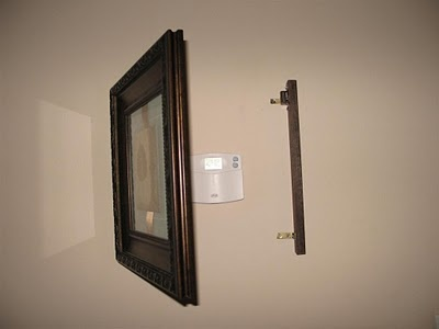 I got sick of looking at our thermostat in the middle of the wall, so I covered it with a nice picture.