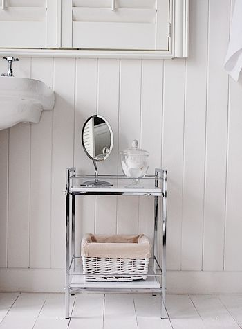 Small white and chrome bathroom shelf unit, ideal for small spaces in a bathroom for storing towels or vanity shelves