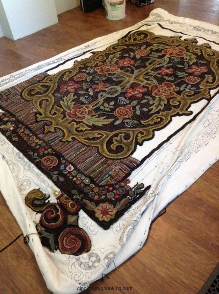 Room sized hooked rug, hooked and designed by Cindi Gay