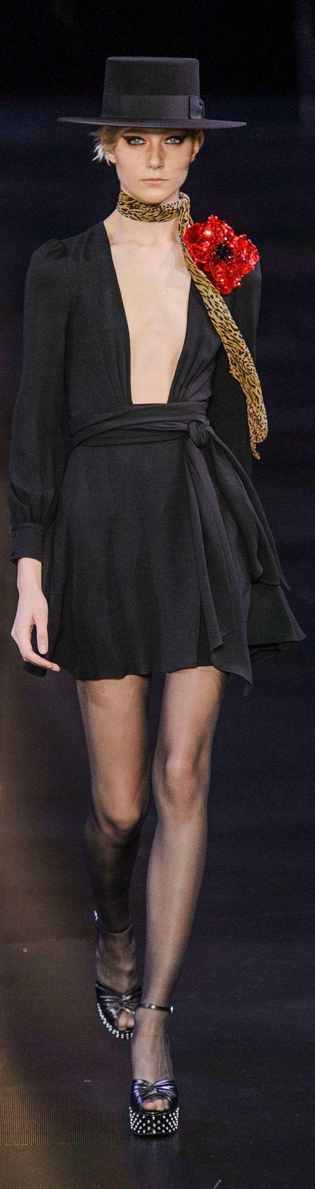 Perfect long-sleeved, intense plunging dress with wrap around belt.