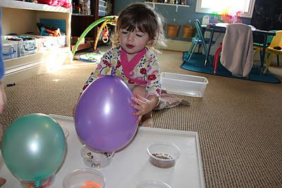 Put different things inside balloons and have the kids match the balloons to containers full of the same thing. Use scissors to deflate the balloons.
