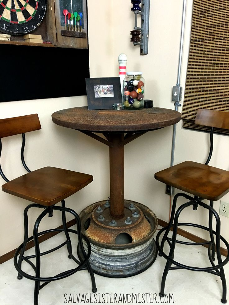 Industrail bar table made from a manhole cover and a wheel base. This upcycle table is a conversation piece for sure. Great for our game room.