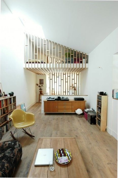good idea for a loft, having the bed in the upper part, over looking the sitting area. kitchen perhaps below it.