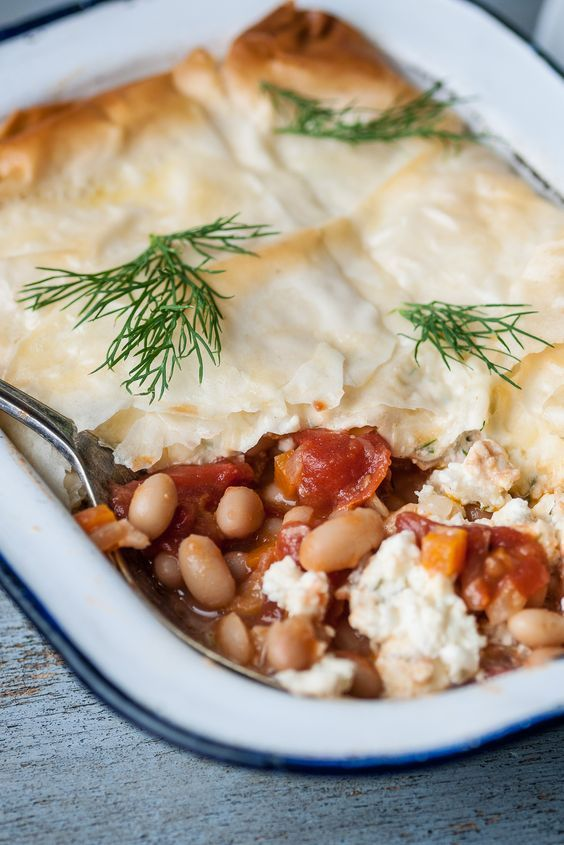 Made as individual pies or as one large dish, this vegetarian pie recipe is full of flavour, texture and hearty ingredients. Dominic Chapman makes a delicious baked bean filling for his pies, before layering with flaky filo pastry and a simple feta and cottage cheese mix for a creamy contrast.