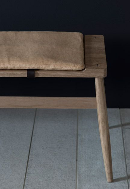 The Imo bench by Pinch Design - seats 3. Upholstered pad with leather fasteners optional. Dimensions: 1670w x 430d x 430h Finishes: white oiled oak seat and legs.  Fabric: COM or supplied by PINCH. £795 inc vat
