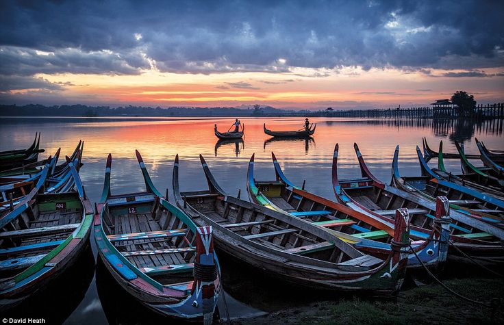 Fishermen making their way out onto the water, shot at sunrise from the shores of Taung Tha Man Lake, Amarapura in Mandalay