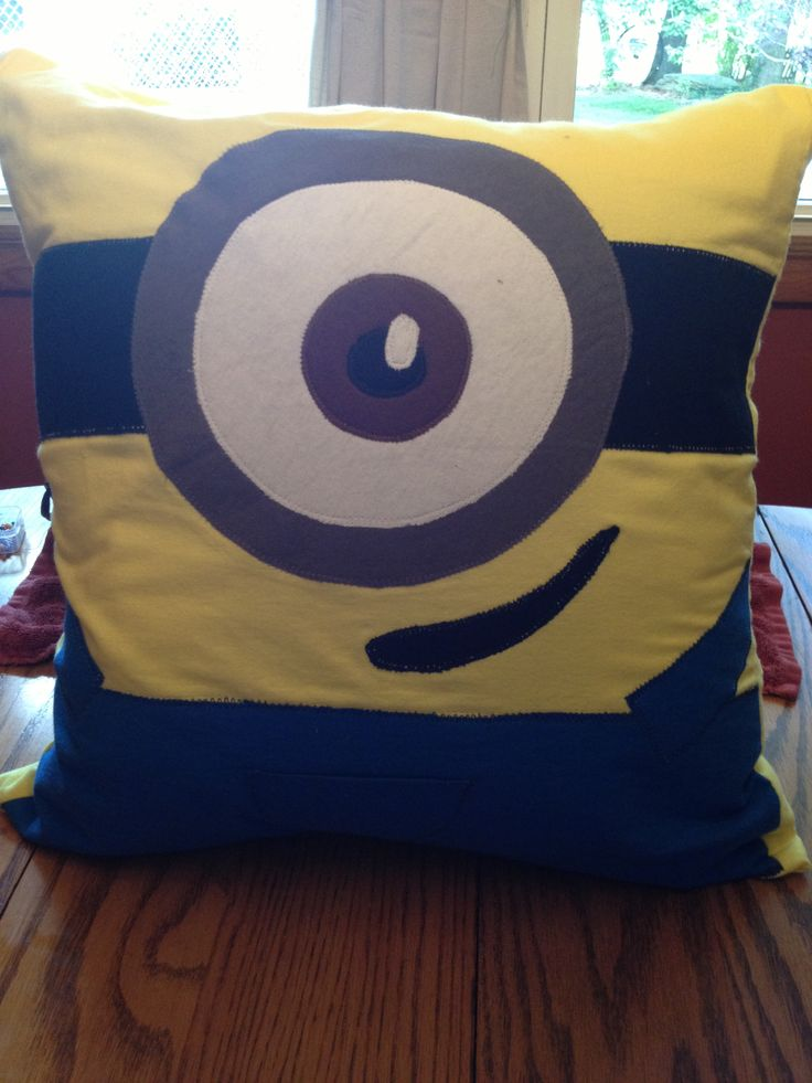 Found this picture on Pinterest and decided to make my own minion!!!  20x20 pillow 3/4yd yellow 1/2yd blue 1/2yd grey 1/2yd white  1/8yd black  1/8yd brown  1yd wonder under I had extra of all the colors but yellow but I'd rather have too much than too little