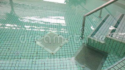 Pool entry - shaking water surface and reflections.