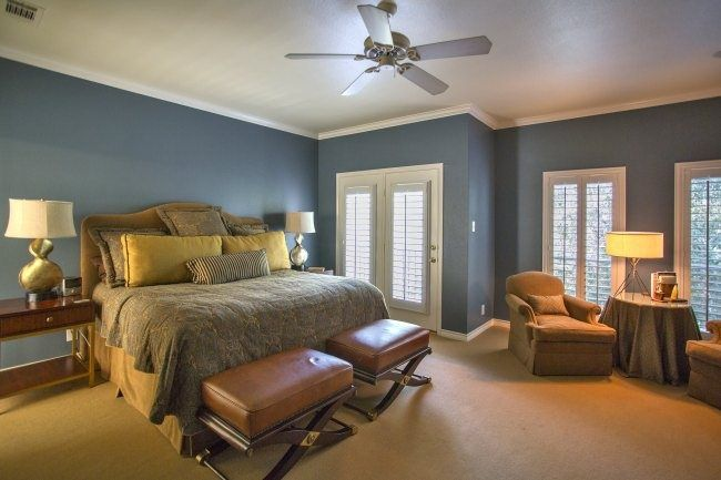 Traditional Master Bedroom with Ceiling fan, Medium Beige Frieze (Twisted) Carpet, French doors, Carpet, Crown molding