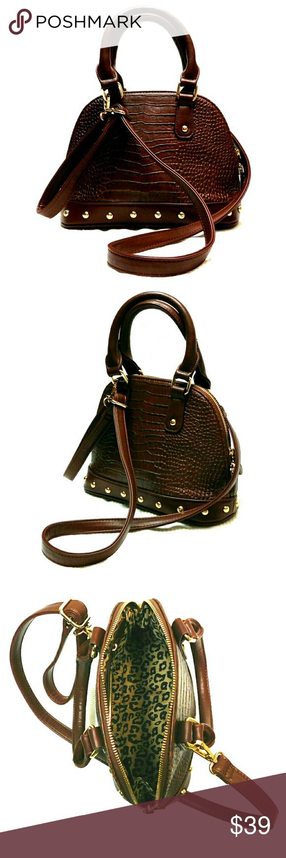 "💕NEW💕DREAM CONTROL BROWN CROC EMBSSD CROSSBODY 💕NEW💕 DREAM CONTROL BROWN CROC EMBOSSED CROSSBODY BAG Not Leather Brown Croc Embossed w/Gold Accents. 2 Side Handles (Drop 4""), Adjustable Crossbody Strap Zippered Dome Shape Opening w/Leopard  Lining  Interior Zip Pouch w/Gold Signature Plate Gold Accents on Interior Approx Meas;    L   12    H   8""    W   4 1/2""    Strap Drop   17"" Please See All Pics. Ask ? If Not Sure DREAM CONTROL Bags Crossbody Bags"