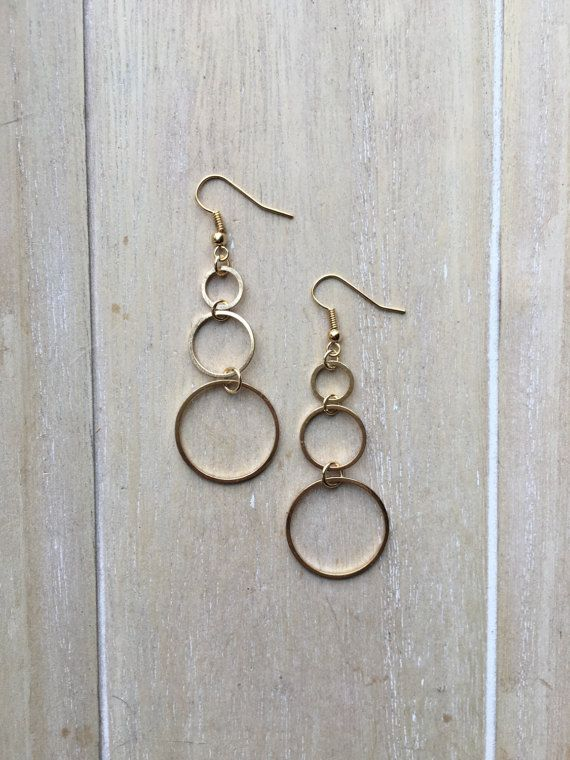 Long gold colored dangle earrings with three circles
