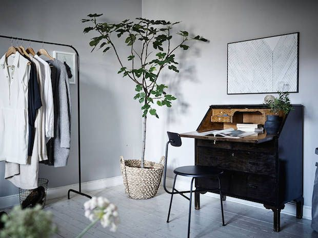 A home office / work spot in a calm, cocoon-like Swedish space in greys. Stadshem.
