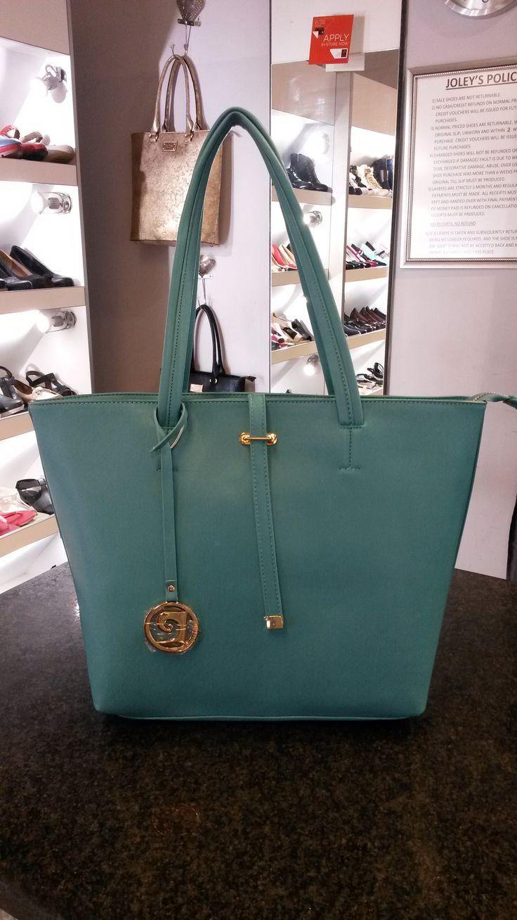 Turquoise/Aquamarine Patent Leather handbag by Pierre Cardin