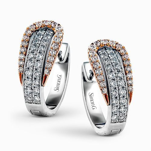 The modern design of these white and rose gold earrings is accentuated by .84 ctw of glistening round cut white diamonds.