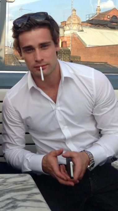 Christian Cooke smoking a cigarette (or weed)