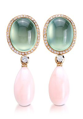 A pair of 18K yellow gold earrings, set with peridot and coral stone in the center and diamonds around. By Padani