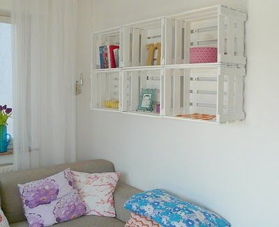 Crates on the wall, painted white: nice! #DIY #used #recycle