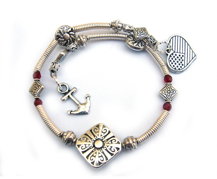 Memory, here with red crystals, our amazing customizable Military Bracelet by www.militaryapparelcompany.com specializing in custom handbags, purses and accessories crafted from personal military uniforms. We also offer Military Blankets and awesome Military gifts for the entire family! www.facebook.com/militaryhandbag