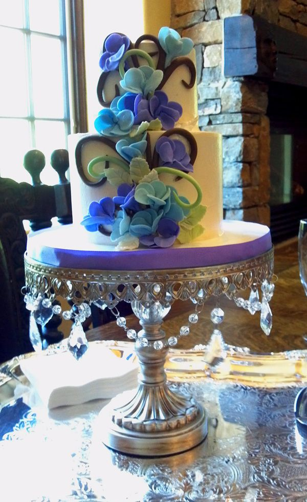 Blue And Purple Sugar Flowers Cascade Down This Elopement Wedding Cake.