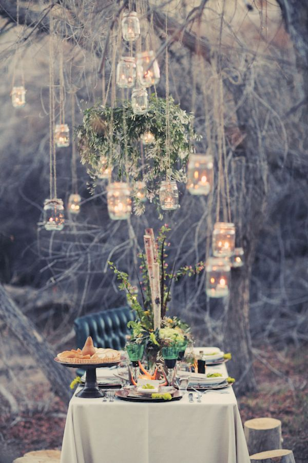 woodland fairytale wedding, love this table set up it because it has being styling to the theme perfectly and that the centre piece is not just on the table though hangs from the tree above it, which draws  your eye to above the tables as well.