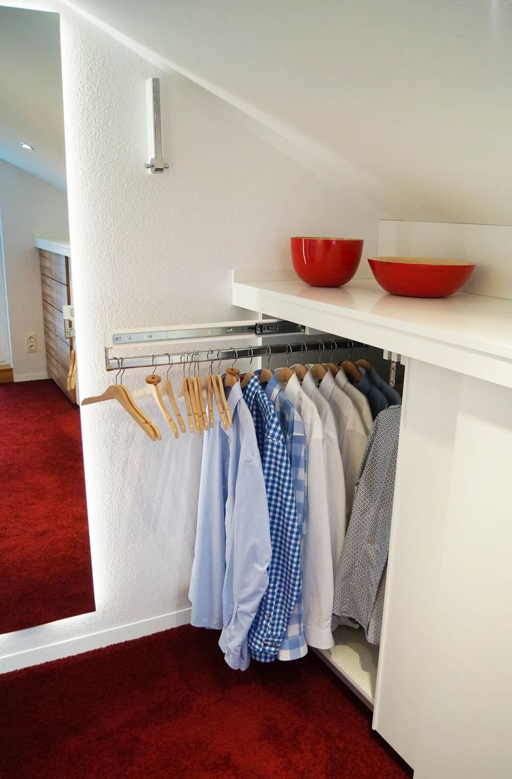 Practical – pull-out clothes rails for wrinkle-free shirts: Dressing room of carpentry & interior fuchsloch
