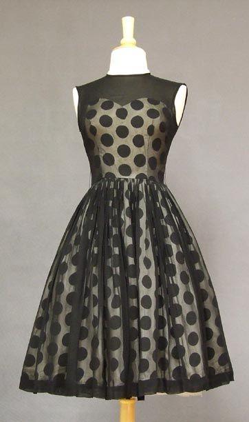 Vintage polka dot dress. Love that silhouette! <3