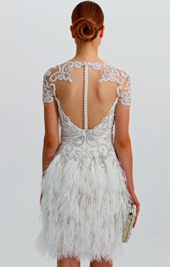 LWD backless wedding dress with feathers from Marchesa