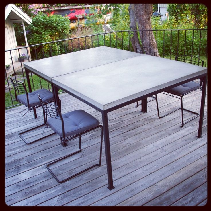 Monikadesign table in grey concreate and black steel
