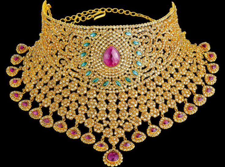 A Stunning 22 K Gold Bridal Choker By Kuber Diamonds Studded With Uncut Diamonds In Floral Pattern. The Beauty Of The Choker Is Enhanced With Emeralds And Rubies.
