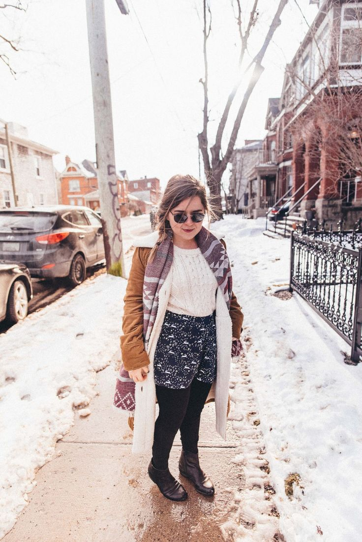 Floppy hat, cable knit sweater, black booties, shorts over leggings, sherpa jacket, winter style inspiration.