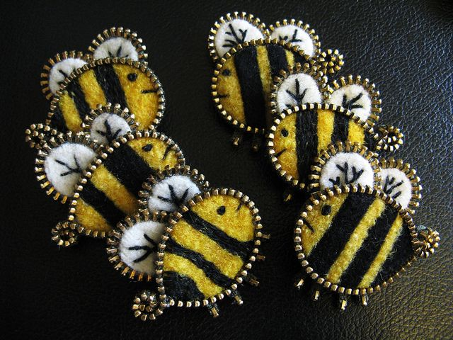 Playing around with some tiny bees made of zippers and wool