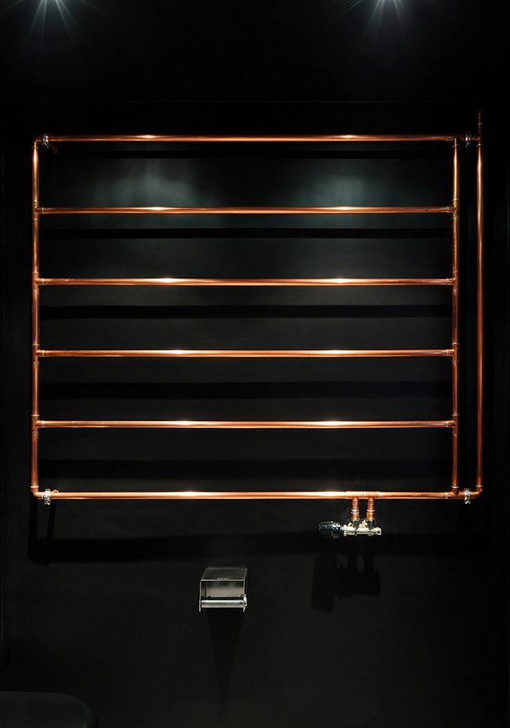 RAUM404 art apart berlin designboom ; the handmade radiator evokes the old pipes now hidden underground