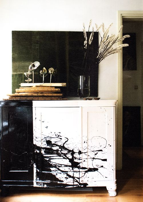 It's from the Amsterdam home of Leslie Oschmann (owner of Swarm).  After looking at it closer, I thought something like this would be fairly simple to re-create, and probably fairly fun too for a weekend project!  I think the trick here is the black and white, painting one area black and then splattering the black onto the white à la Jackson Pollock–style.