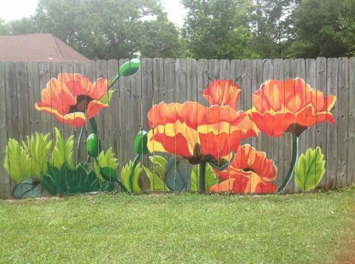 Painted poppies on fence