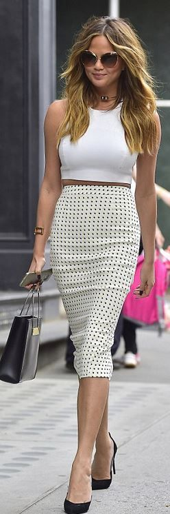 Who made Chrissy Teigen's dot skirt and black tote handbag?