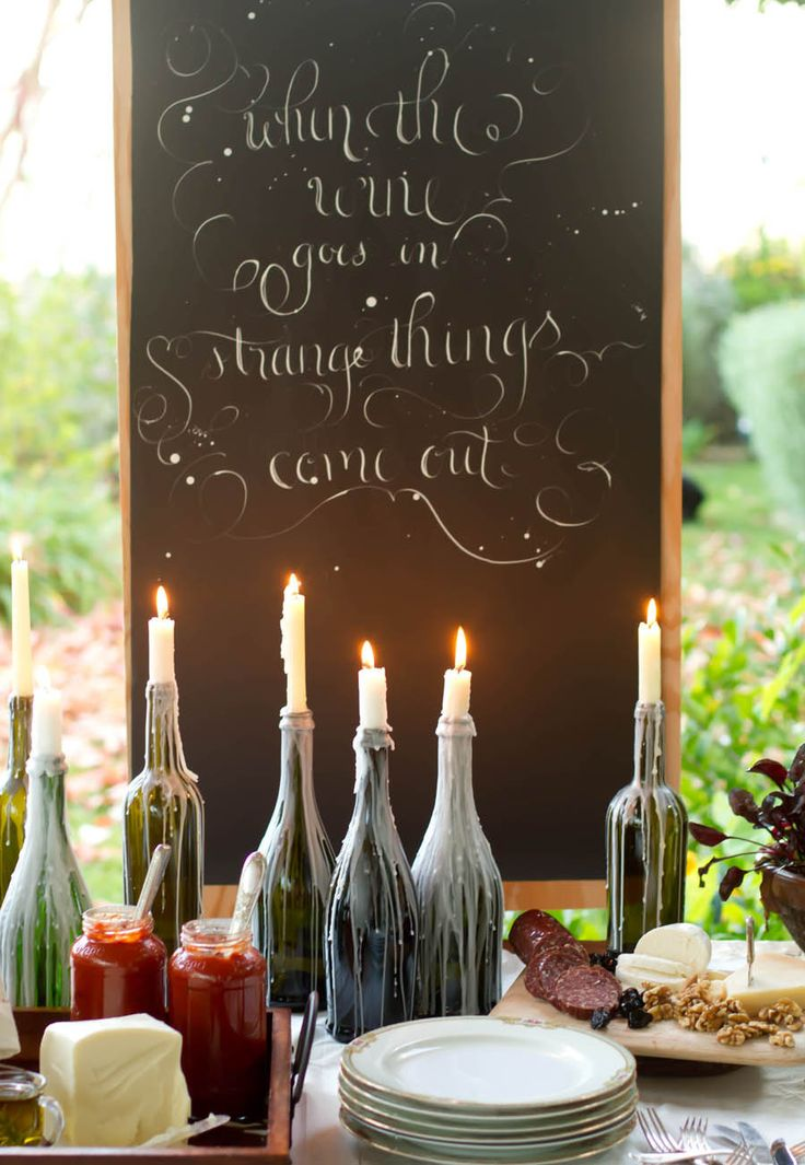 dinner party // love the wonderful messiness of the bottle candle holders. I wouldn't have thought...