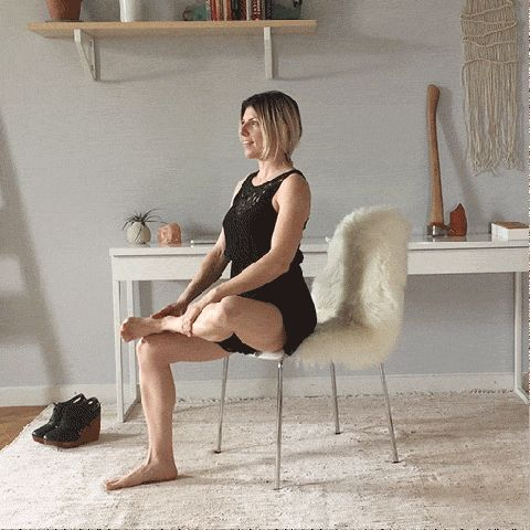 Yoga at your desk? Yes. How to do 8 poses—including the Seated Pigeon Pose here—that will un-kink computer crouch, get blood pumping, ease the mind, and more—all without standing up.