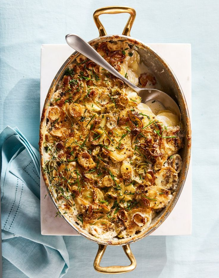 Scalloped Potatoes with Leeks | Thinly sliced potatoes and leeks soak up a mixture of milk, cream and broth in this recipe, an easy-to-assemble but luxurious accompaniment to a ham or other roast meats.