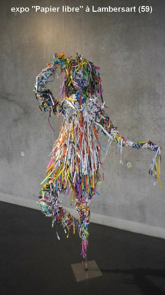 rolled paper dancer, so pretty! and made from recycling!
