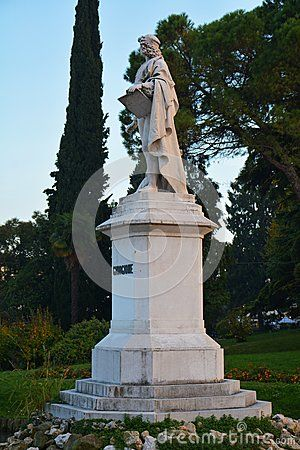 Giorgione statue and trees in Castelfranco Veneto, in Treviso, Italy, by night.