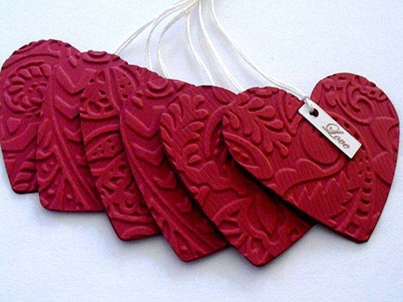 Embossed red HEART tags by stephaniematsunaka on Etsy