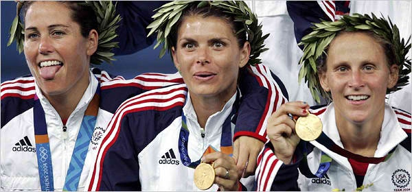 Julie Foudy, Mia Hamm, and Christine Lily after winning the Olympics in Greece.