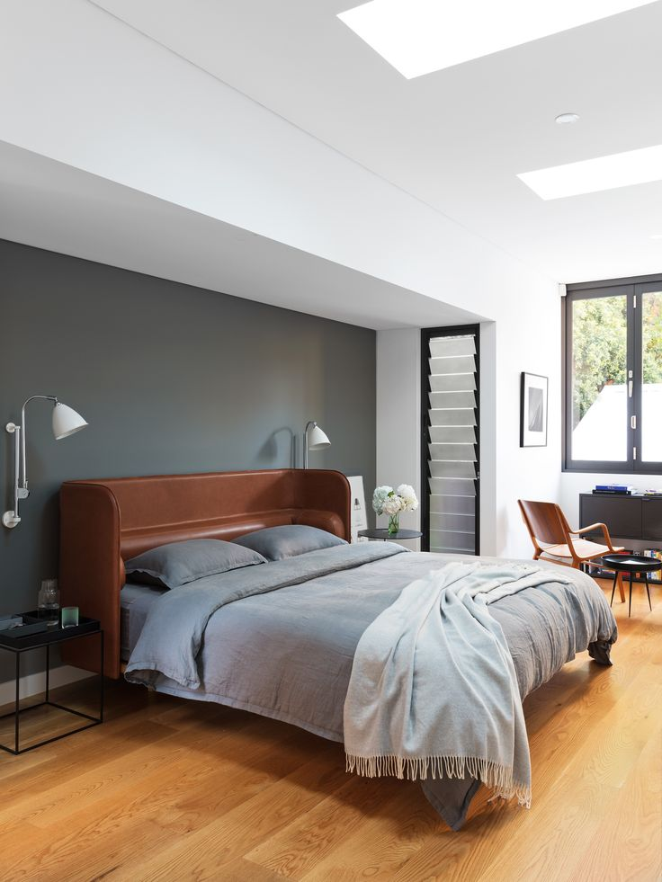 This bedroom in a renovation of a narrow terrace in inner Sydney features an 'Aran' bed by Adam Goodrum. Photography: Stephan Julliard | Styling: Lucy McCabe