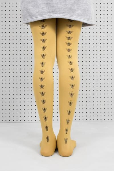 Save the bees and keep them on your legs! Our hand screen printed bees really stand out on the rich vibrancy of the 100 denier mustard tights. Wear them with anything! We like grey and mustard. Machine wash delicate 30º 94% Nylon 6% Elastane As each pair is hand-printed they may vary slightly from the photo but they are all beautiful!
