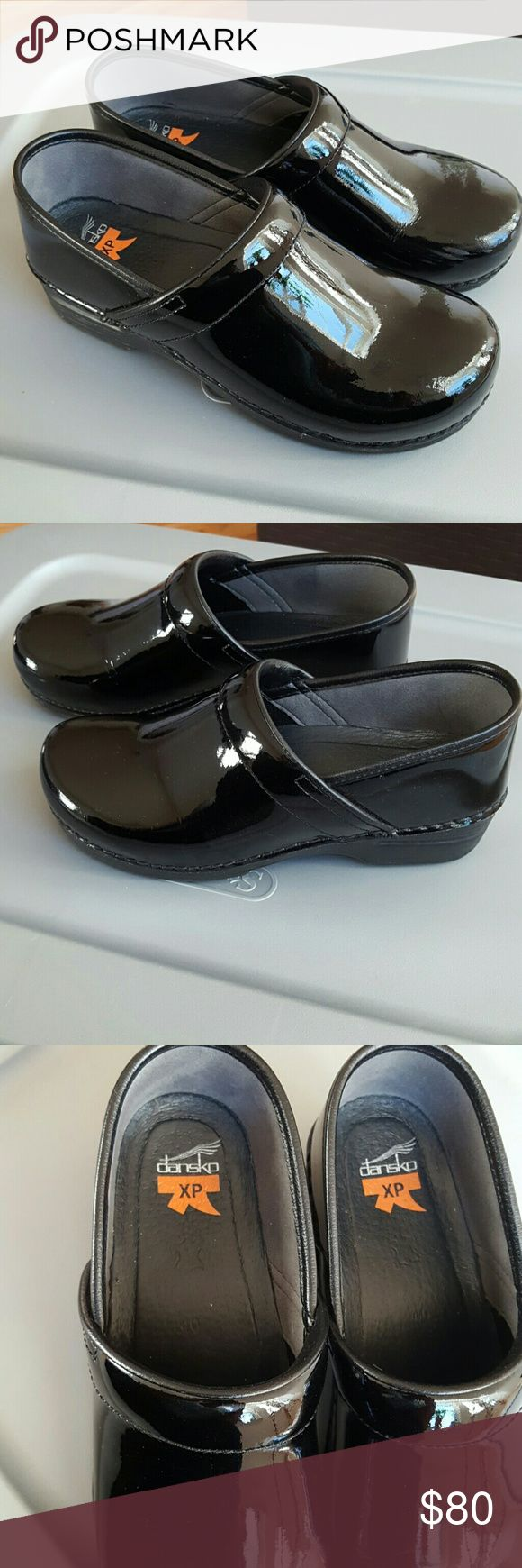 Dansko Profesional XP Clogs I originally purchased these Dansko XP Clogs from Posh Mark but size is to small for me.  I never wore them.   They're in excellent like new condition.    Size 40 or US size 10.  Color. Shiny black patent leather with a black clog sole.   Frome a smoke and pet free home.  Please message me if you need more pictures or information.   Thank you: -) Dansko Shoes Mules & Clogs